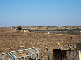 A general view picture shows a security fence near the border area between Israel and Syria in the Golan Heights, November 18, 2020.