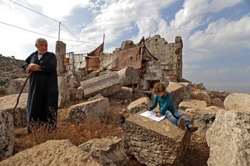 Displaced Syrians are pictured at the UNESCO-listed site of Baqirha not far from the Turkish border on November 1, 2020