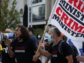 Sadi Ben Shitrit, left, during a demonstration against the Netanyahu government in Holon, October 15, 2020.