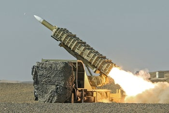 A missile is launched during a military drill, with the participation of Iran's Air Defense units, Iran October 20, 2020.