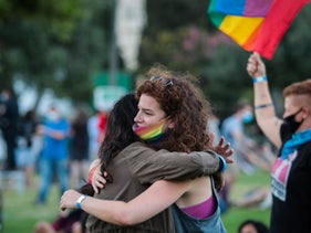 Attendees hug at an LGBT rights rally in Jerusalem, June 28, 2020.