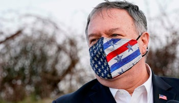 U.S. Secretary of State Mike Pompeo takes part in a security briefing on Mount Bental in the Israeli-annexed Golan Heights, near Merom Golan on the border with Syria, on November 19, 2020.