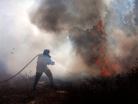 A firefighter in action in southern Israel, August 11, 2020.