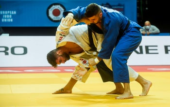 Israel's Peter Paltchik (white) competes with Bulgarian Boris Georgiev during the men's under 100kg weight category quarter final at the European Judo Championship 2020, Prague, November 21, 2020.