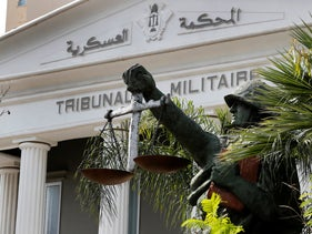 A statue of soldier carries balance, symbol of justice, is seen outside the military court in Beirut, Lebanon, Wednesday, May 27, 2020