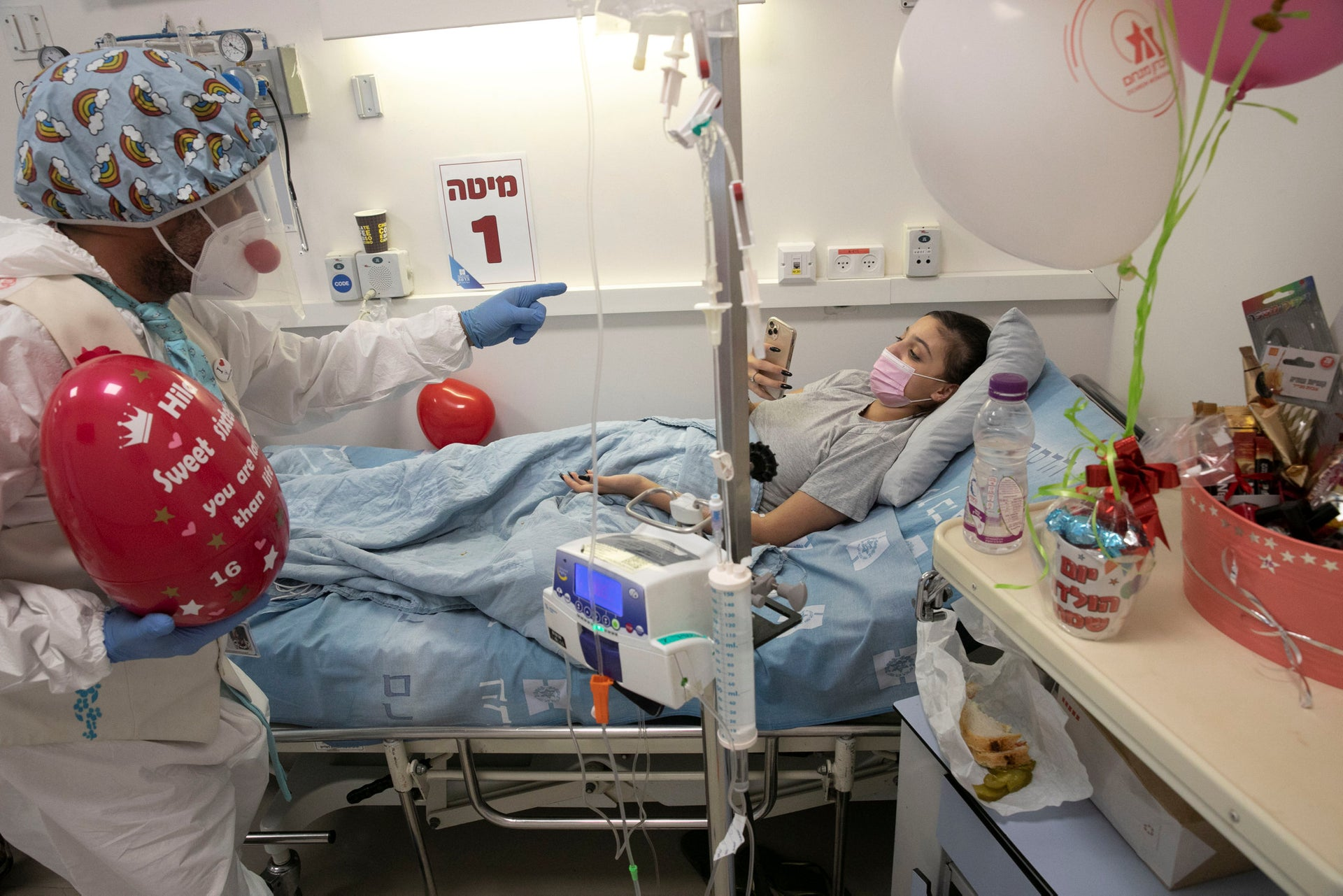 Medic clown David Barashi is visiting a young patient at the COVID-19 ward in Hadassah Ein Kerem Hospital in Jerusalem.