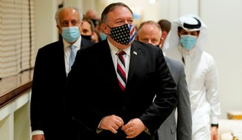 U.S. Secretary of State Mike Pompeo arrives for a meeting with Taliban's negotiators in the Qatari capital Doha, on November 21, 2020.