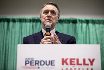 Sen. David Purdue addresses a crowd of supporters in Perry, Georgia, November 19, 2020.