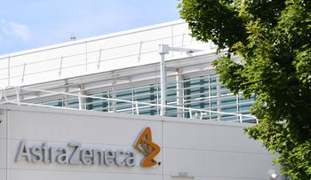 A sign is pictured outside the AstraZeneca factory in Liverpool north west England on July 20, 2020.