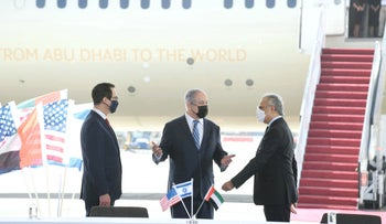 Netanyahu greets dignitaries ahead of the signing ceremony for UAE deal at Ben Gurion airport, October 20, 2020.