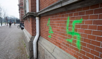 A Swastika, painted on the wall of the Stedelijk Museum, is seen in Amsterdam, Netherlands, Friday, Feb. 22, 2019.