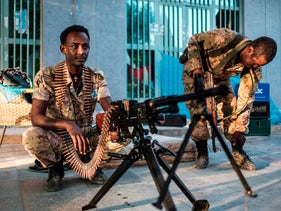 A member of the Amhara Special Forces sits next to a machine gun in Humera, Ethiopia, November 22, 2020.