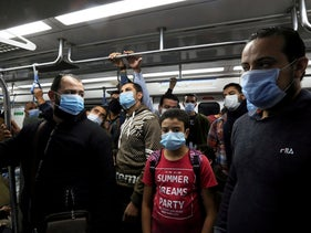 "People wearing protective face masks at the underground Al Shohadaa ""Martyrs"" metro station while Egypt ramps up its efforts to slow down the spread of COVID-19 in Cairo, Egypt, November 21, 2020"