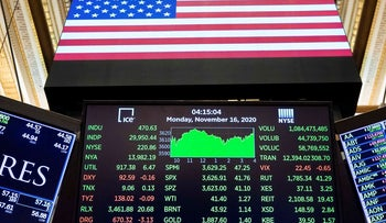 In this photo provided by the New York Stock Exchange, a board above a trading post shows the closing number for the Dow Jones Industrial Average, at the NYSE, Monday Nov. 16, 2020, in New York