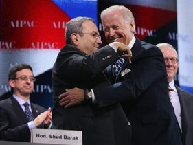 Then-Defense Minister Ehud Barak, left, embracing then-Vice President Joe Biden at AIPAC in Washington, April 2013.