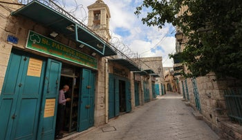 A street with souvenir shops for tourists near the Church of the Nativity in the occupied West Bank town of Bethlehem, remains deserted on November 8, 2020
