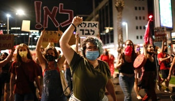Protesters march through Tel Aviv, calling for action on violence against women, August 2020.