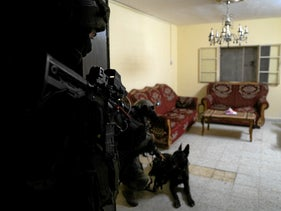Israeli security forces raid a home in the West Bank.