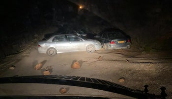Cars and stones block the road that leads into the Kumi Ori outpost, November 25, 2020.