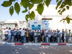 Palestinians queue in front of the Interior Ministry office in East Jerusalem, 2017