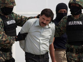 "In this Saturday, Feb. 22, 2014 photo, Joaquin ""El Chapo"" Guzman is escorted to a helicopter in handcuffs by Mexican navy marines at a navy hanger in Mexico City, Mexico. Guzman, the head of Mexico's Sinaloa Cartel, was captured overnight in the beach resort town of Mazatlan. (AP Photo/Eduardo Verdugo)"