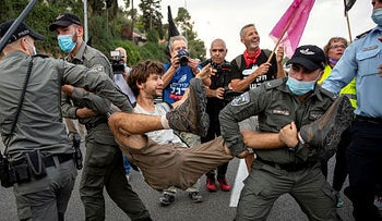 An anti-Netanyahu protester being arrested by the Israel police during a protest march to Jerusalem, November 14, 2020.