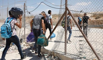 Palestinians passing through from the West Bank to work in Israel, through a breach in the separation fence. Illustration.
