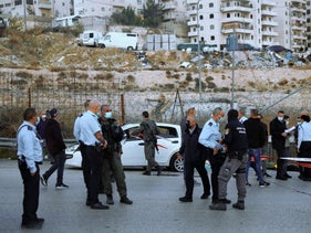 Israeli police inspect the scene of what they say was an attempted car-ramming attack at a West Bank checkpoint near Jerusalem, Wednesday, Nov. 25, 2020.