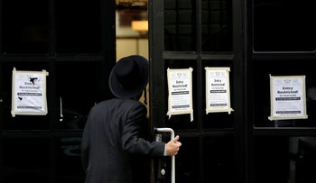 A person enters the Congregation Yetev Lev D'Satmar synagogue in the South Williamsburg neighborhood of Brooklyn, New York City, U.S., October 19, 2020.