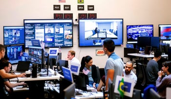 Employees work in a Facebook unit focused on the fight against misinformation and manipulation in Menlo Park, California in 2018.