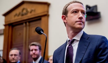 Facebook CEO Mark Zuckerberg arrives for a House Financial Services Committee hearing on Capitol Hill in Washington, October 23, 2019.