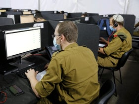 An Israeli soldier works at a computer at the Israel Defense Force's coronavirus command center, September 2020
