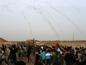 Israeli troops fire tear gas at Palestinian protesters during a demonstration near the border with Israel, east of Khan Yunis in the southern Gaza Strip, on April 26, 2019.