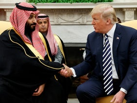 President Donald Trump shakes hands with Saudi Crown Prince Mohammed bin Salman in the Oval Office of the White House.