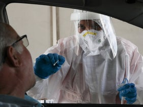 A coronavirus test is administered at a drive-through testing facility, September 2020.