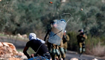 Clashes break out between Israeli soldiers and Palestinians in the West Bank village of Kafr Qaddum, November, 2020.