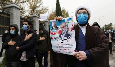 Protesters gather during a demonstration against the killing of Mohsen Fakhrizadeh in Tehran, Iran, November 28, 2020.