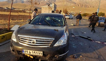 A photo made available by Iran state TV on November 27, 2020, shows the damaged car of Iranian nuclear scientist Mohsen Fakhrizadeh.