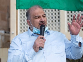 Joint List lawmaker Mansour Abbas speaks at a demonstration outside the French embassy in Tel Aviv, October 29, 2020.