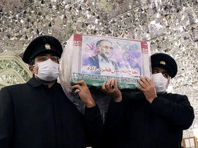 Servants of the holy shrine of Imam Reza carry the coffin of Iranian nuclear scientist Mohsen Fakhrizadeh, in Mashhad, Iran, November 29, 2020.