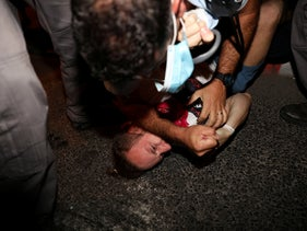 Chief Superintendent Guetta tackles a protester, whose assault complaint was closed, in August 2020.