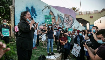 Touma-Sliman speaks at a protest against femicides in Taibeh, July 2020.