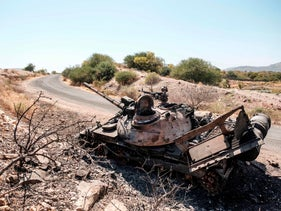 A damaged tank stands abandoned on a road near Humera, in the Tigray region of Ethiopia, November 22, 2020.