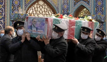 Servants of the holy shrine of Imam Reza carrying the coffin of Iran's assassinated top nuclear scientist Mohsen Fakhrizadeh during his funeral procession, Mashhad, Iran, November 29, 2020.