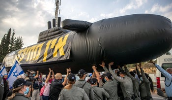 Police forces moving an inflatable submarine during an anti-Netanyahu protest outside Jerusalem, November 28, 2020.