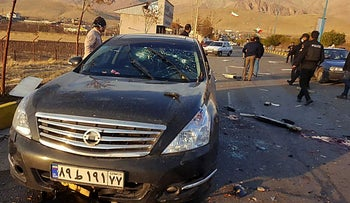 the damaged car of Iranian nuclear scientist Mohsen Fakhrizadeh after it was attacked near the capital Tehran,  November 27, 2020