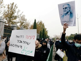 A demonstration in Tehran, featuring a picture of nuclear scientist Mohsen Fakhrizadeh and a sign in Hebrew reading 'Vengence means Tel Aviv will burn on fire,' November 29, 2020.