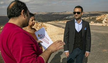 Khaled al-Sabawi, vice chairman of Union Construction and Investment, which is building the new housing project in Turmus Ayya, in the West Bank, with prospective buyers, Dec. 4, 2019
