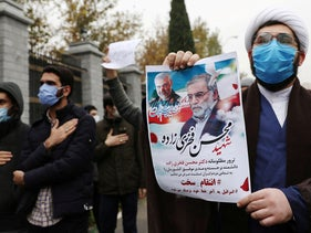 Protesters gather during a demonstration against the killing of Mohsen Fakhrizadeh, Iran's top nuclear scientist, in Tehran, Iran, November 28, 2020