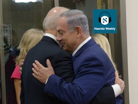 Then-U.S. Vice President Joe Biden (L) and Israeli Prime Minister Benjamin Netanyahu embrace in Jerusalem, September 3, 2016.